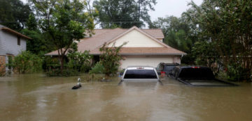 Houses and cars are seen partially submerged by flood waters from tropical storm Harvey in east Houston, Texas, U.S., August 28, 2017. REUTERS/Jonathan Bachman